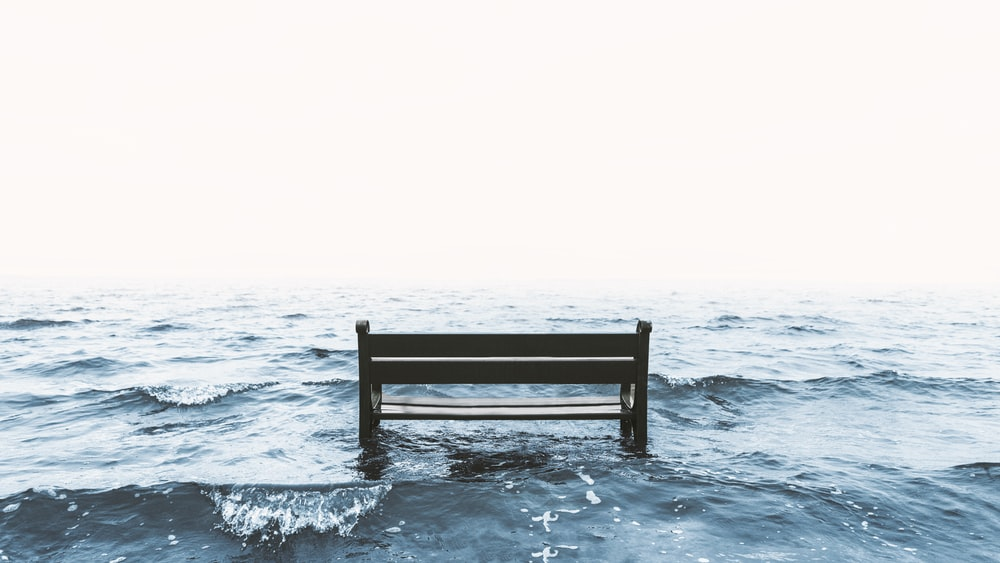 black table on body of water
