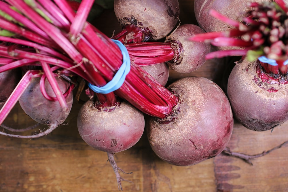 turnips on brown wooden surface