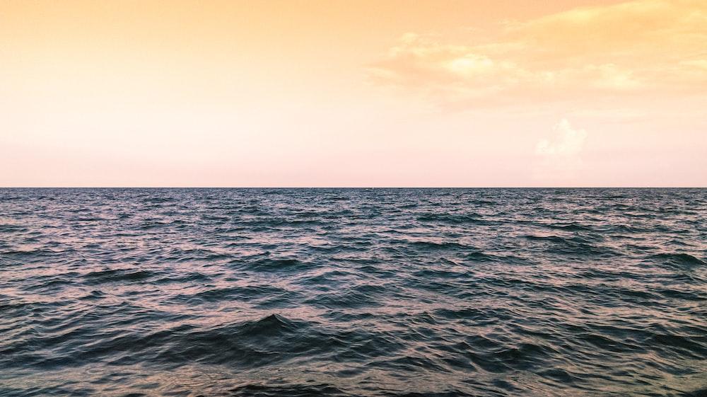 blue sea under golden-hour