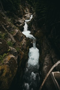waterfalls between rock mountains