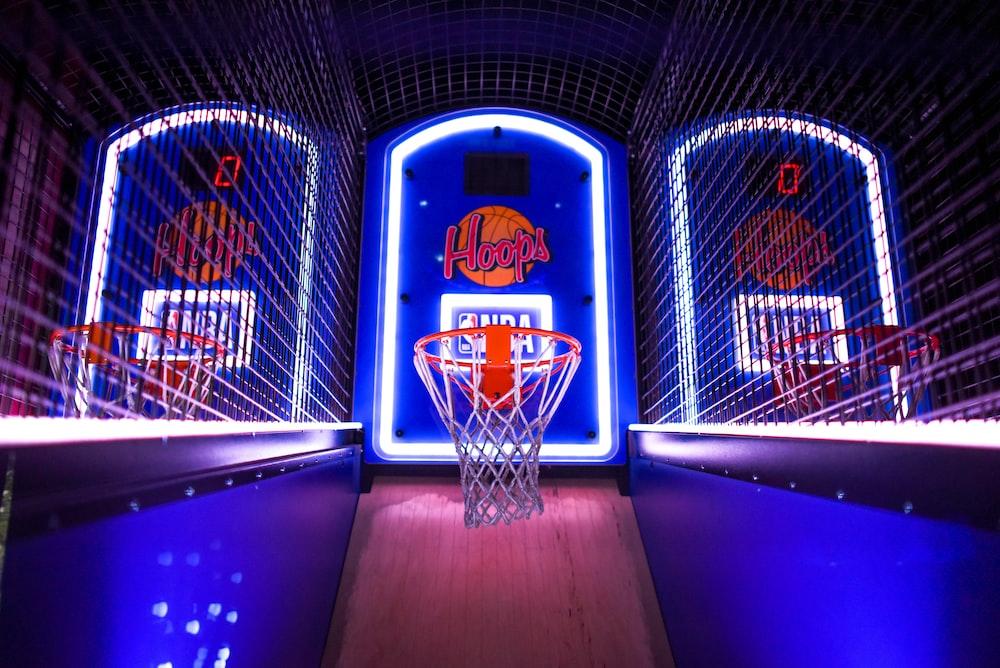three arcade basketball hoops with lights