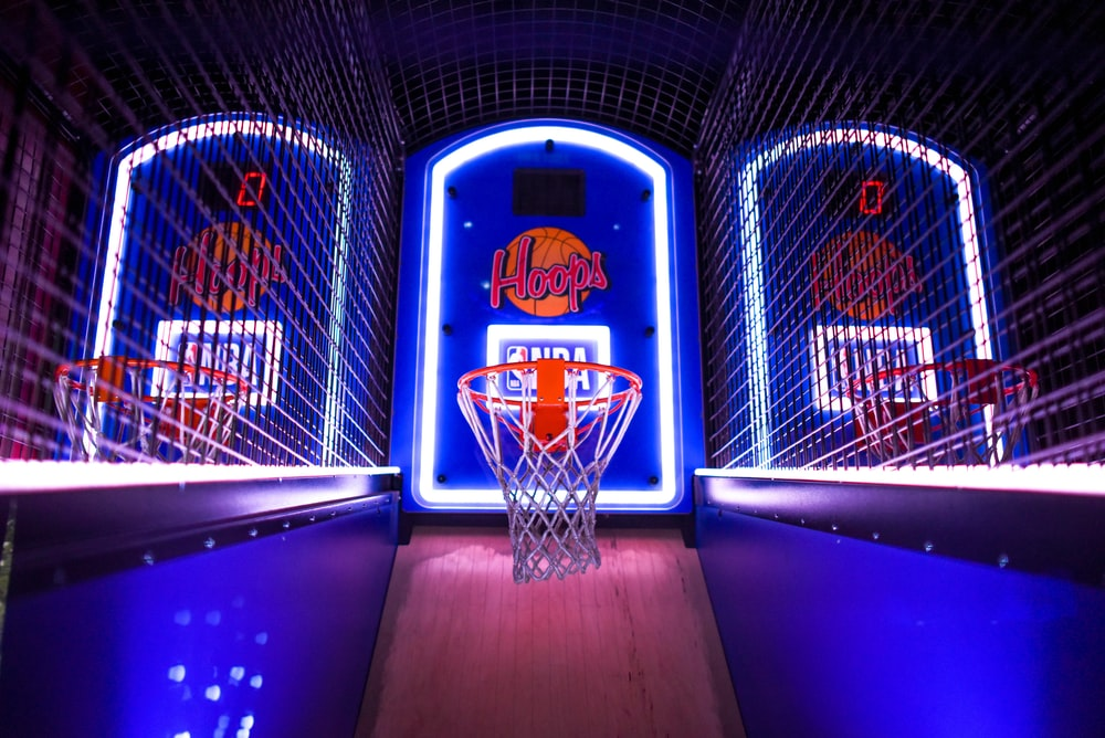 three arcade basketball hoops with lights
