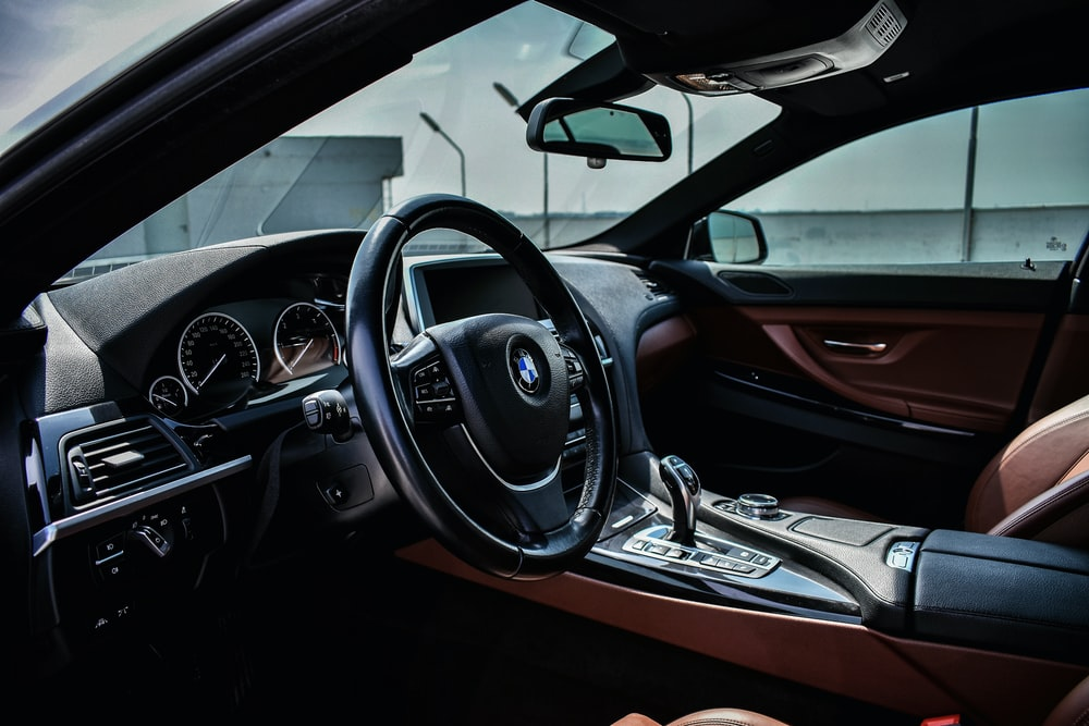 black BMW steering wheel with airbag cover