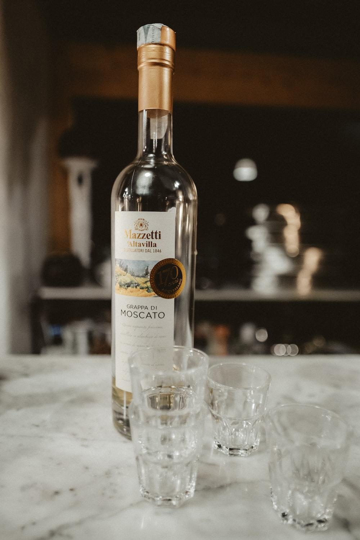 Mazzetti Altavilla moscato bottle with shot glasses on table