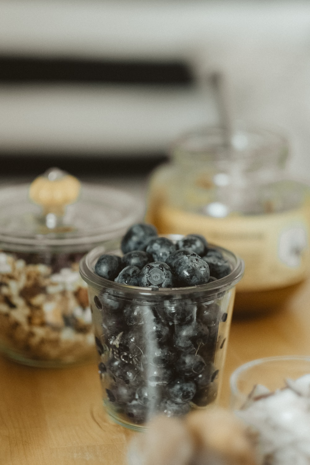 black berries with cup