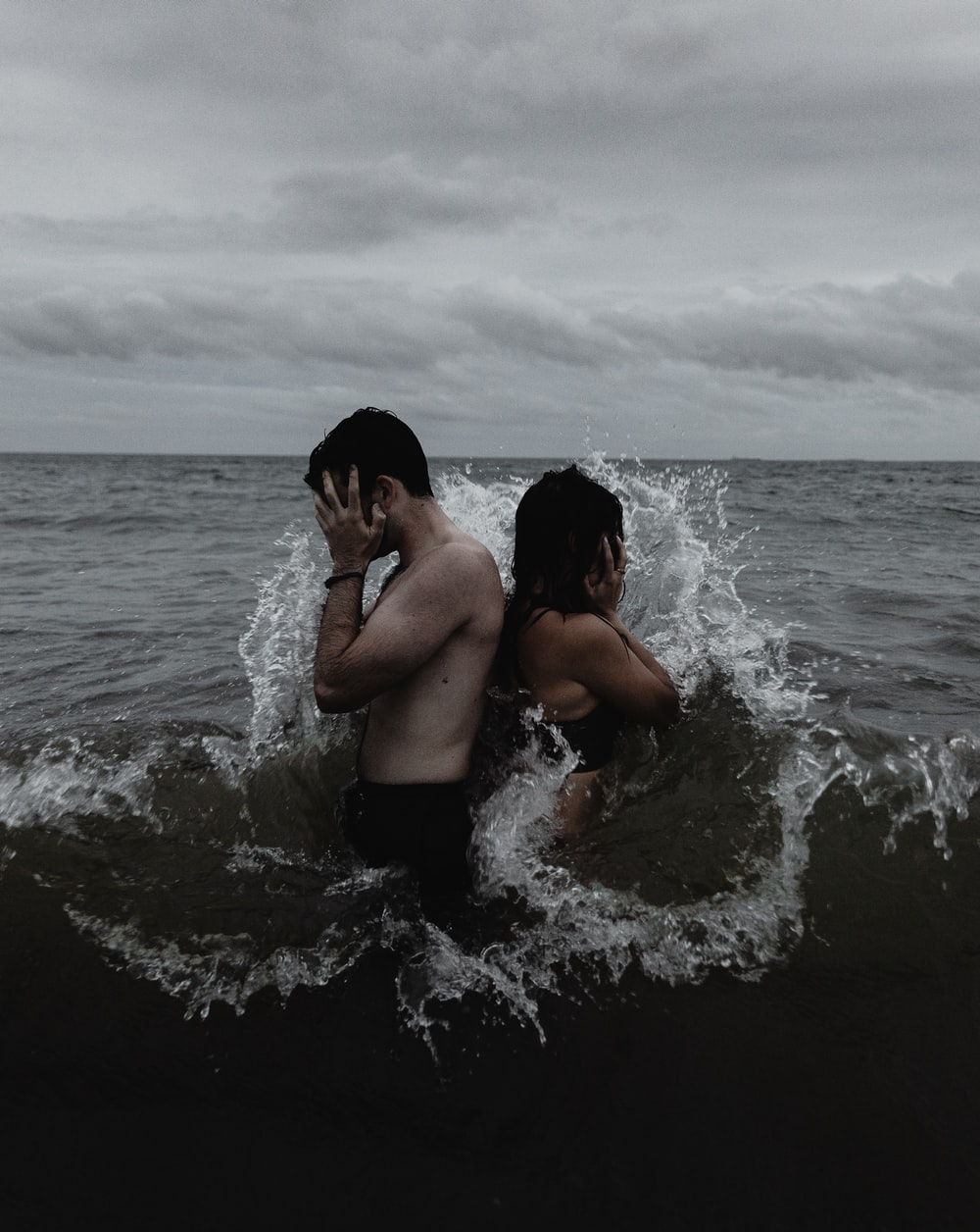 time lapse photography of couple standing on body of water