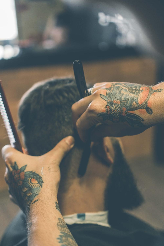 person shaving hair