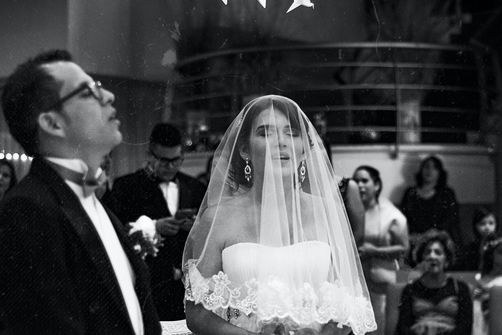 grayscale photography of wedding coupe