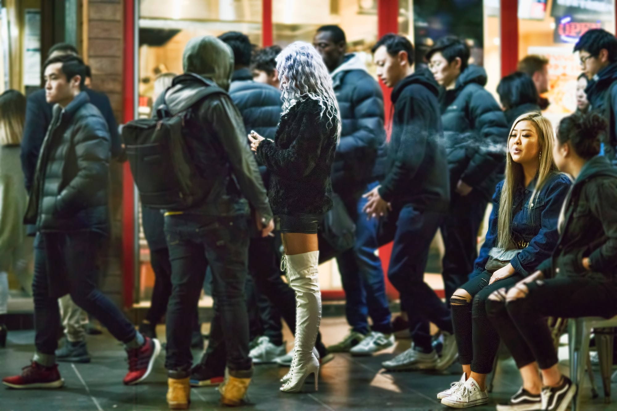 The scene outside a Chinatown night club as the patrons start to gather to make an entrance