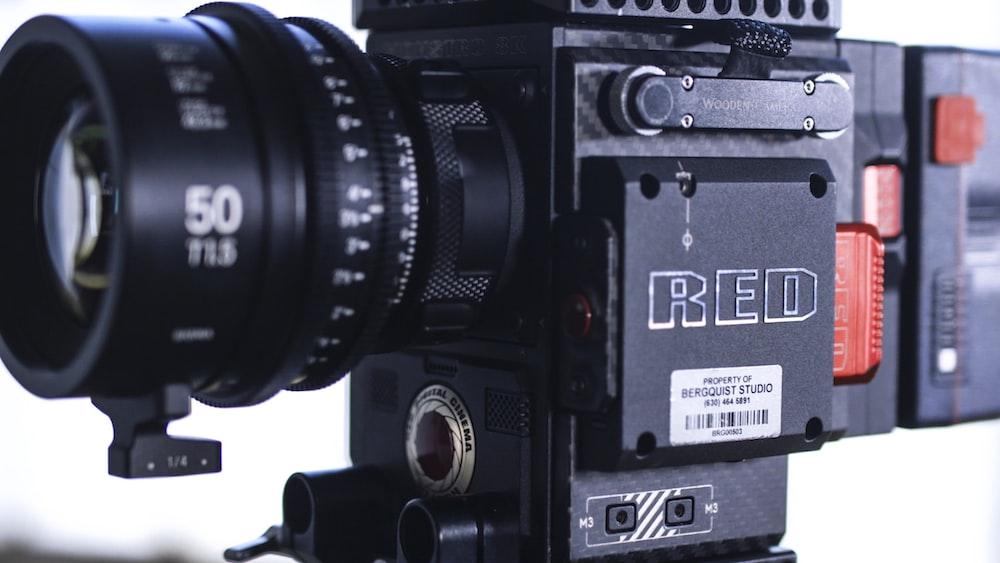 person taking photo of black video camera