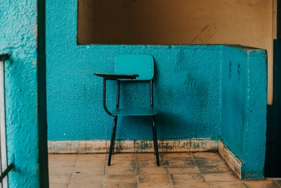 blue and black writing chair beside wall honduras teams background