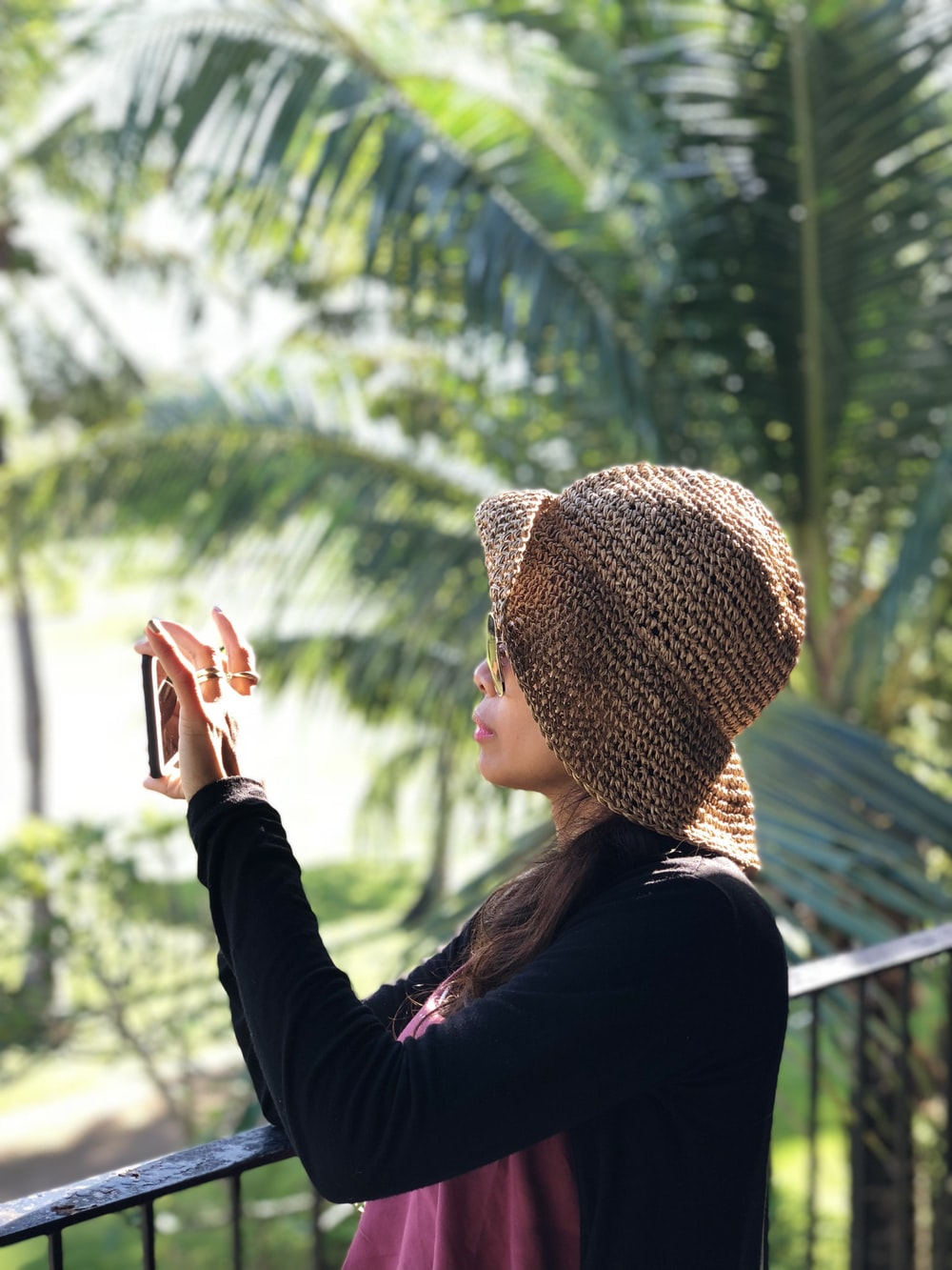 woman taking picture using phone selective focus photography