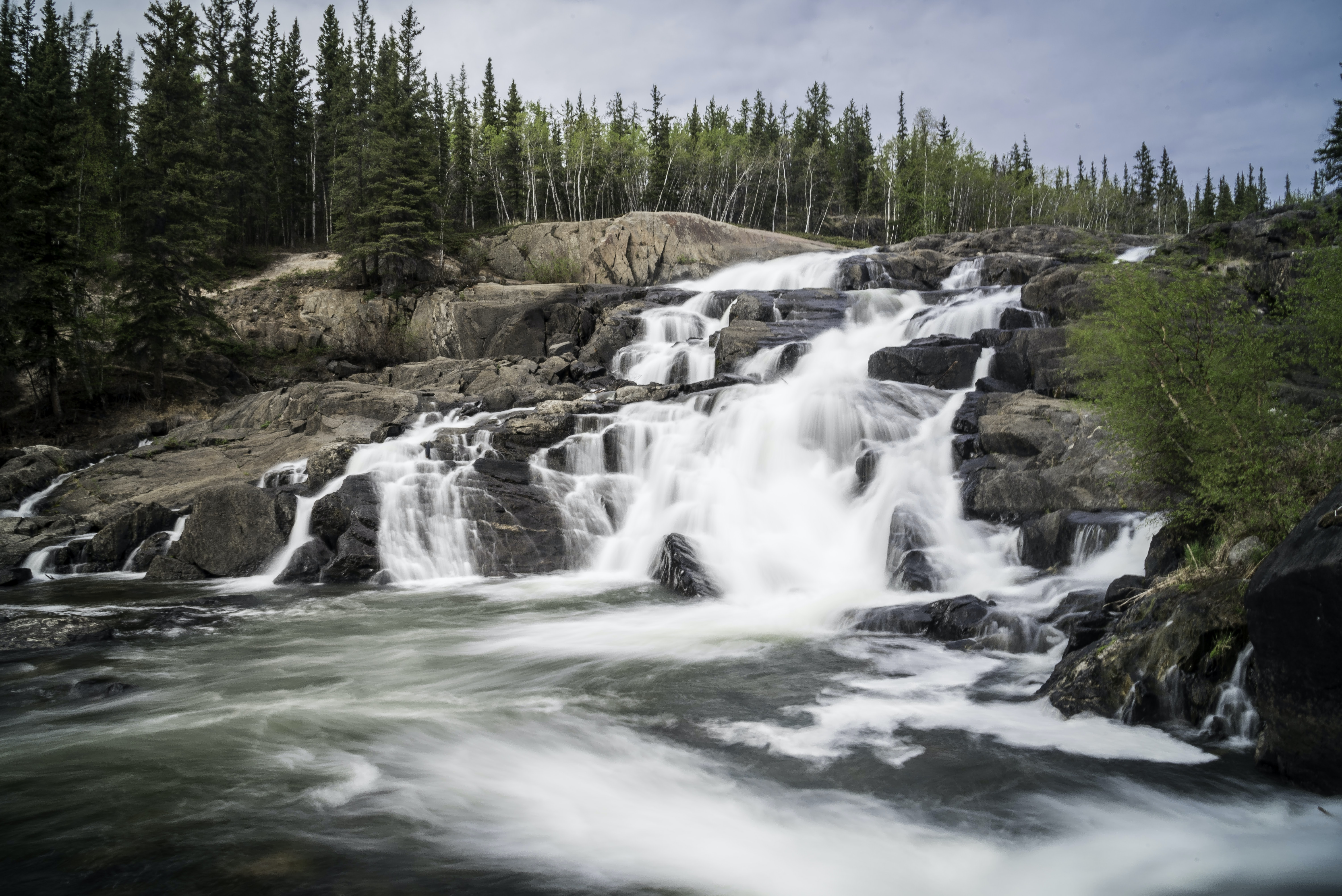 time lapse photography of flowing multi-step waterfall