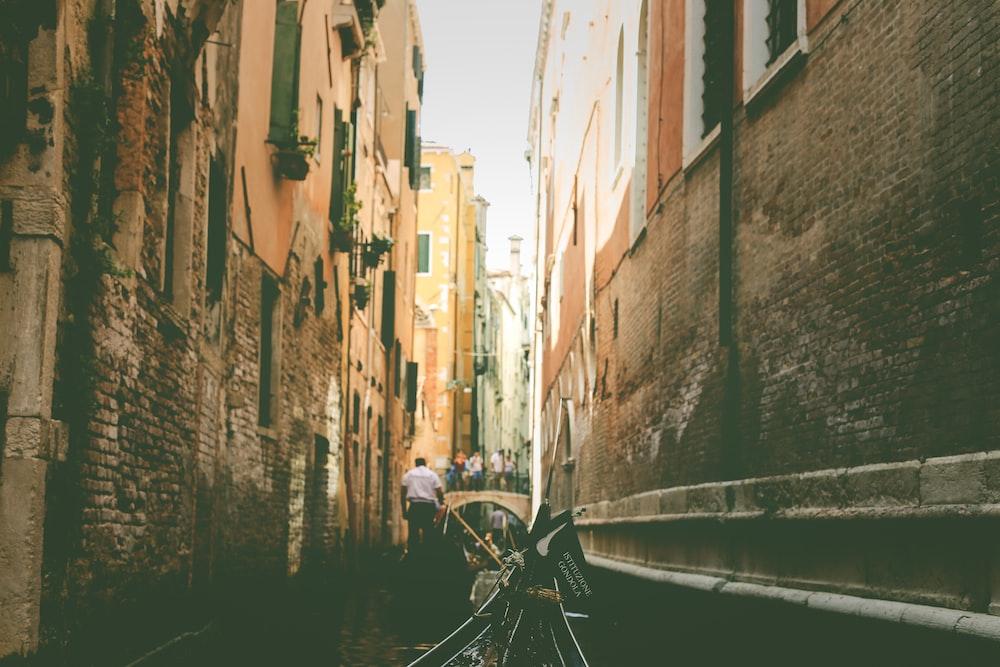 man walking on alley