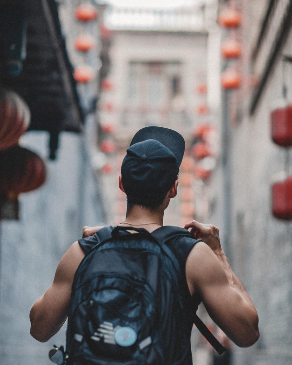man holding black backpack