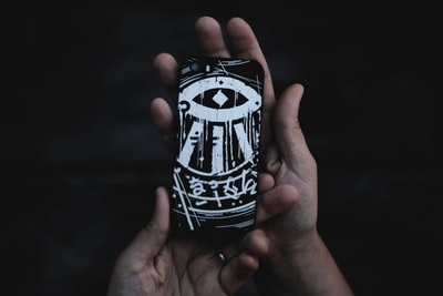 person holding black and white phone case