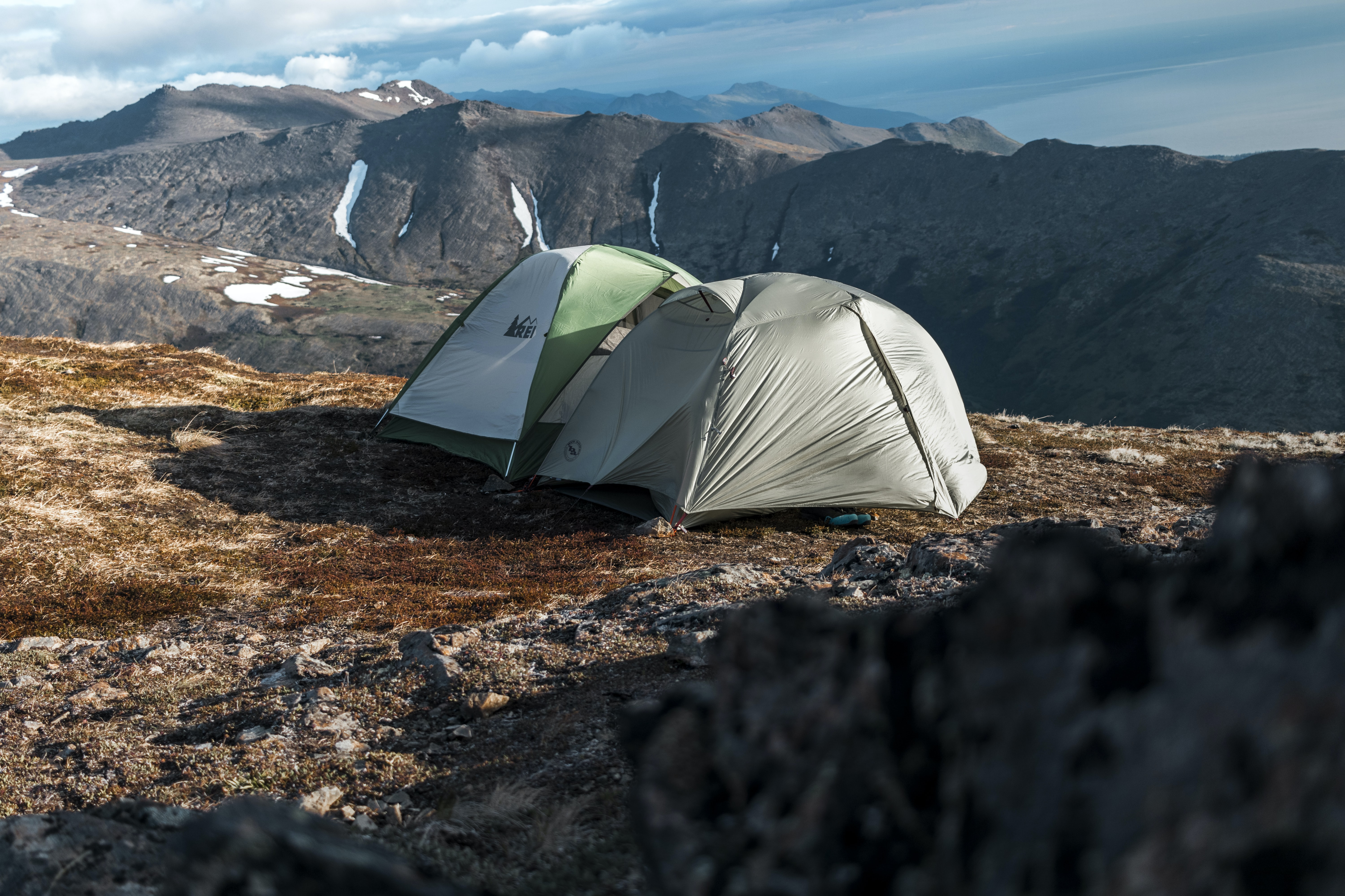 two dome tents on cliff