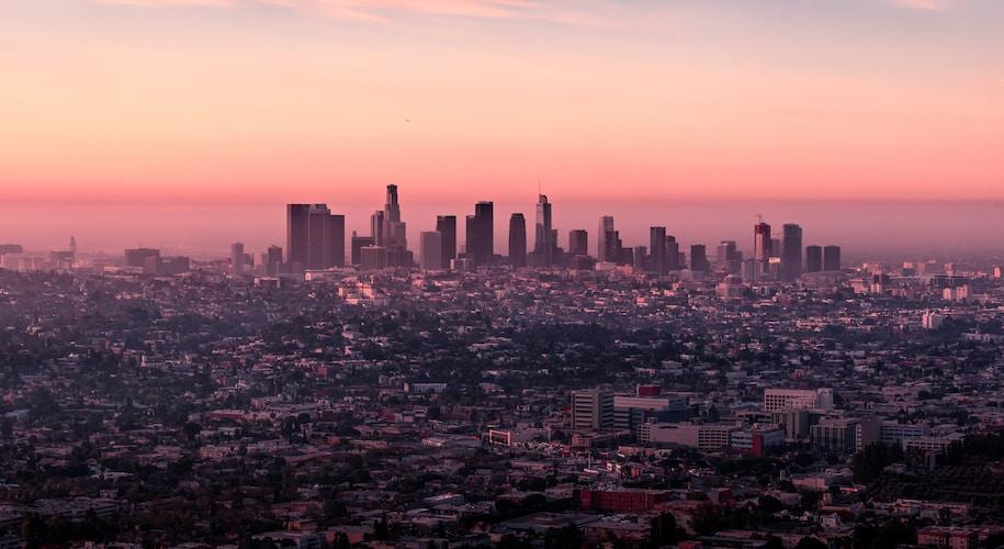 landscape photo of city buildings during dusk
