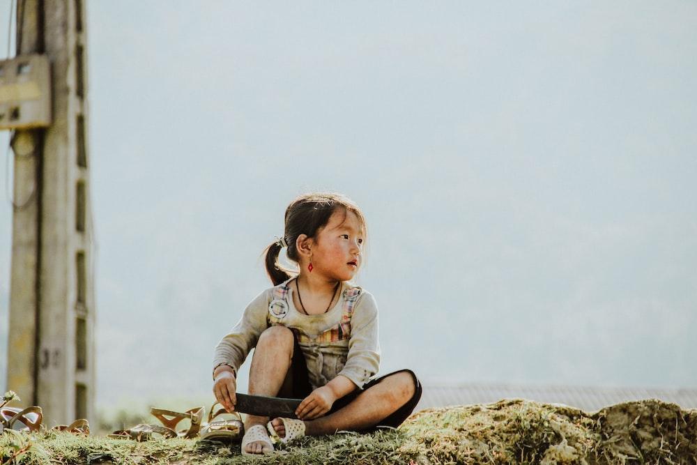 girl sitting on grasses