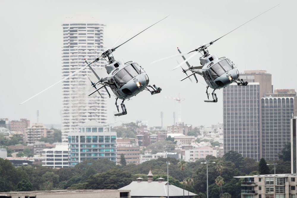 two flying helicopters