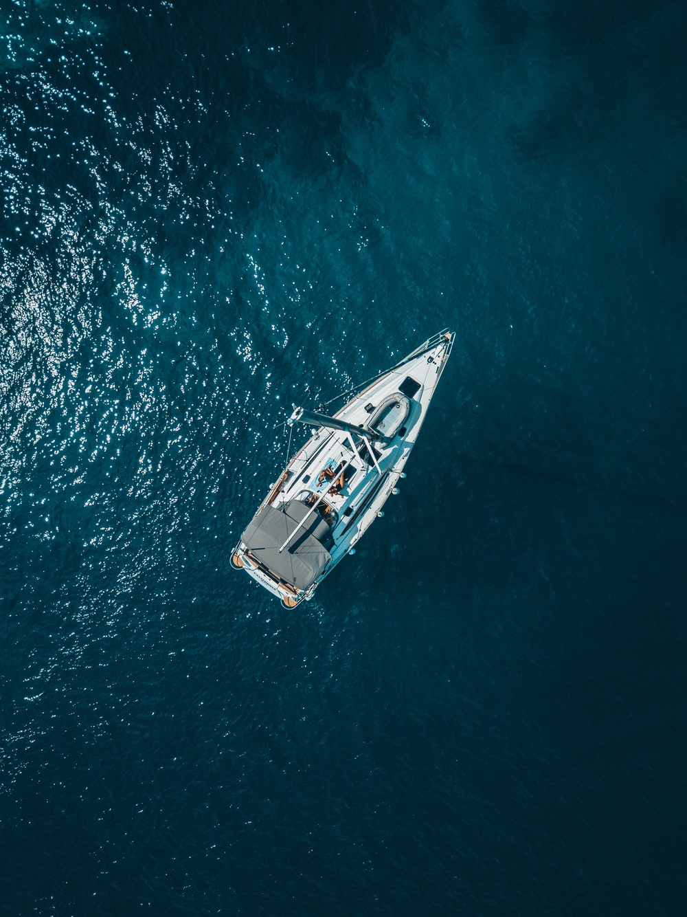 aerial view of white boat sailing
