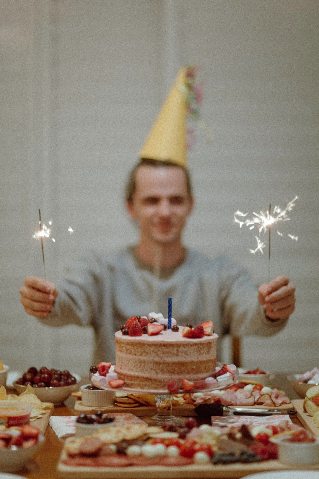 I cam home to a feast mum had prepared of cake, sweets, fruits etc. An idea began to form, I told mum I needed to have a party hat, she whipped one up like the Grinch wrapping up Lucy-Liu up in wrapping, poked some string through either side, tightened around my neck, sat me down, lit the sparklers and boom. HBD to me.