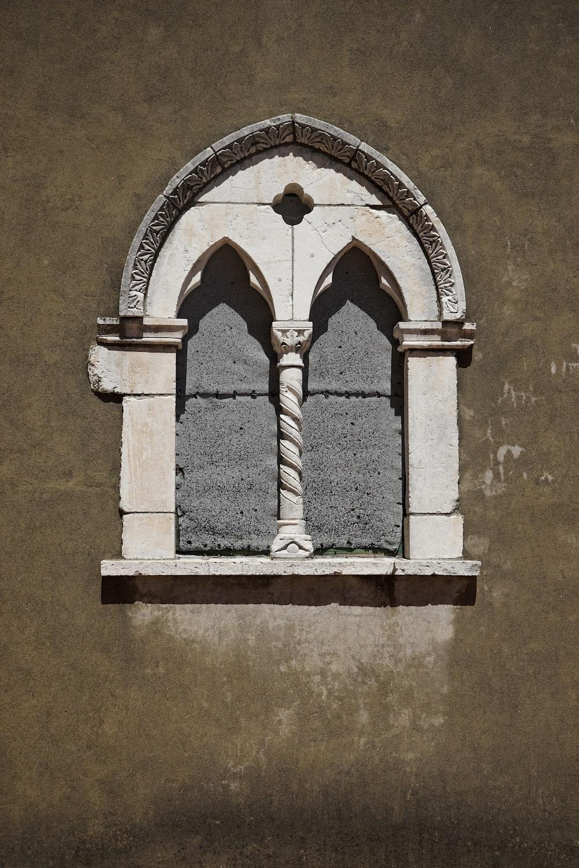 white concrete arch window