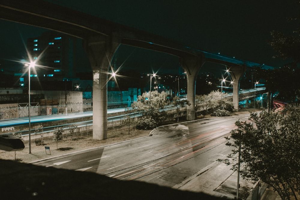 gray concrete road at nighttime