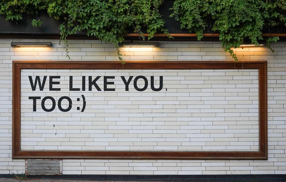 We Like You signage on white tile
