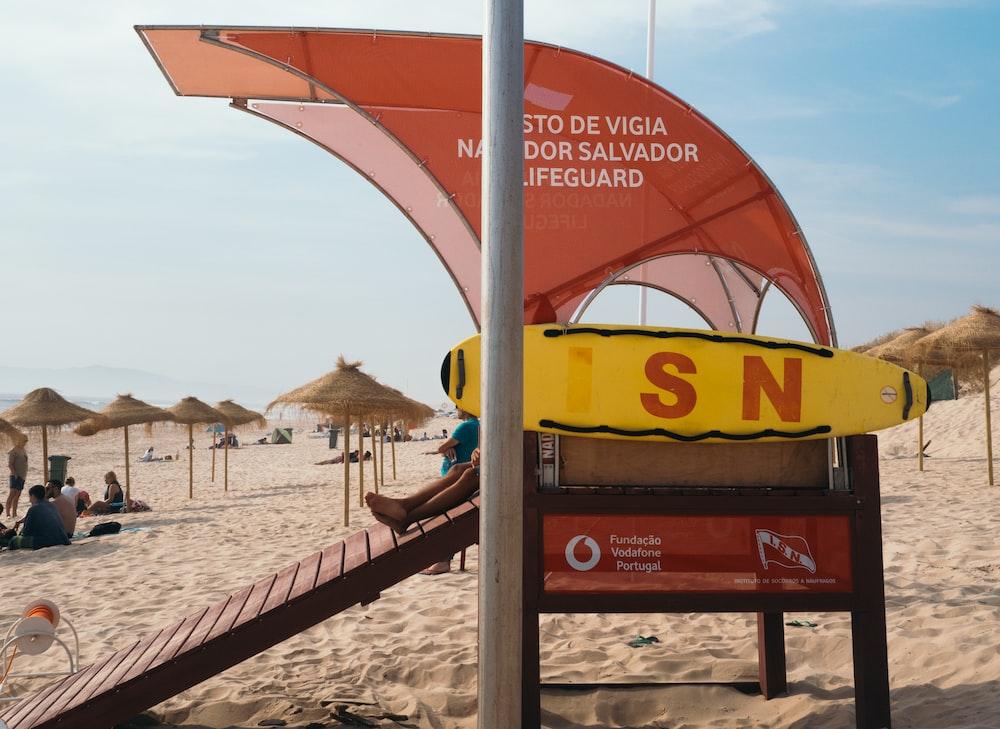 Lifeguard booth on beach under blue sky