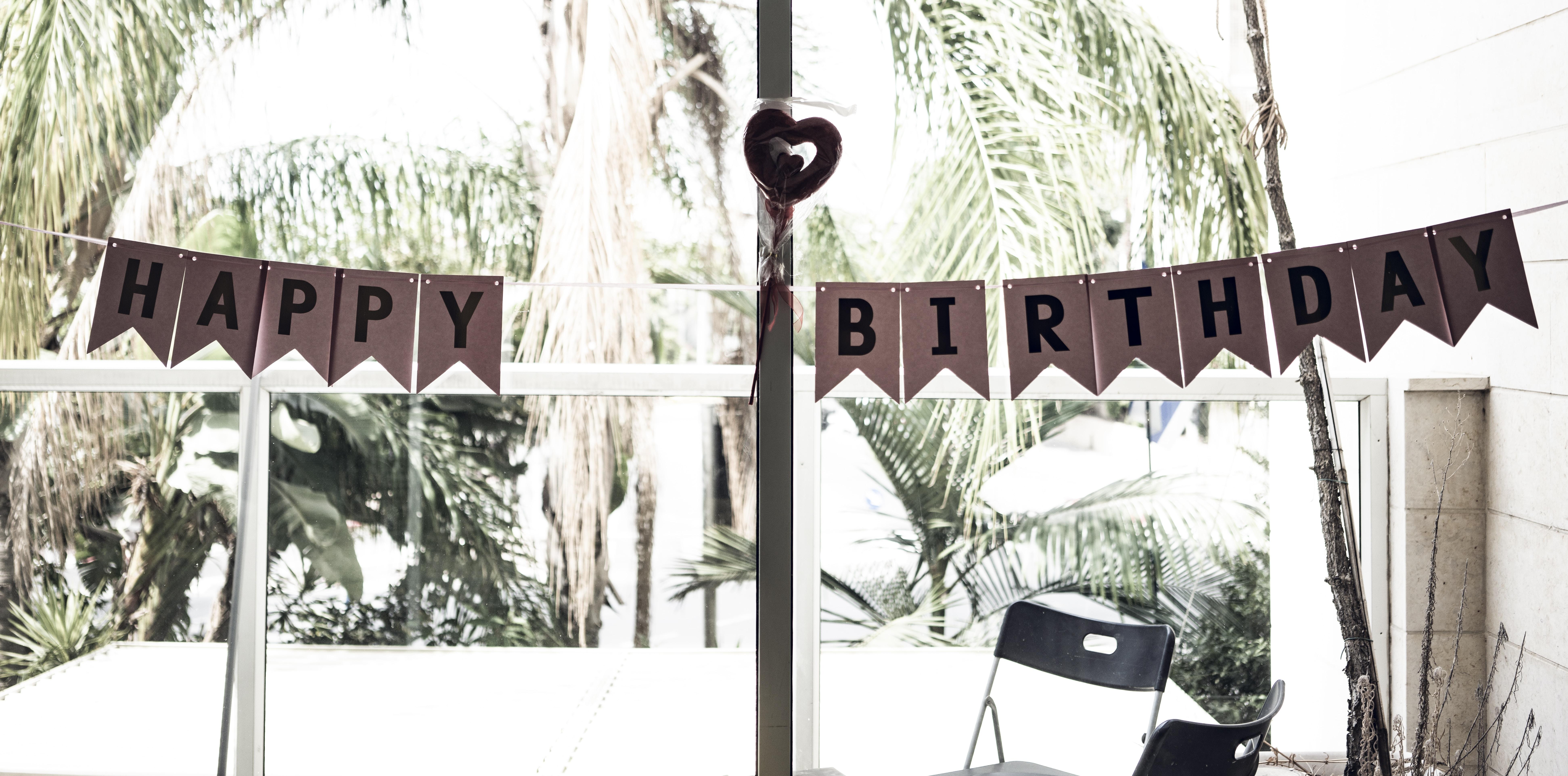 black chair near happy birthday bunting