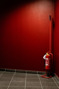 red fire extinguisher on corner