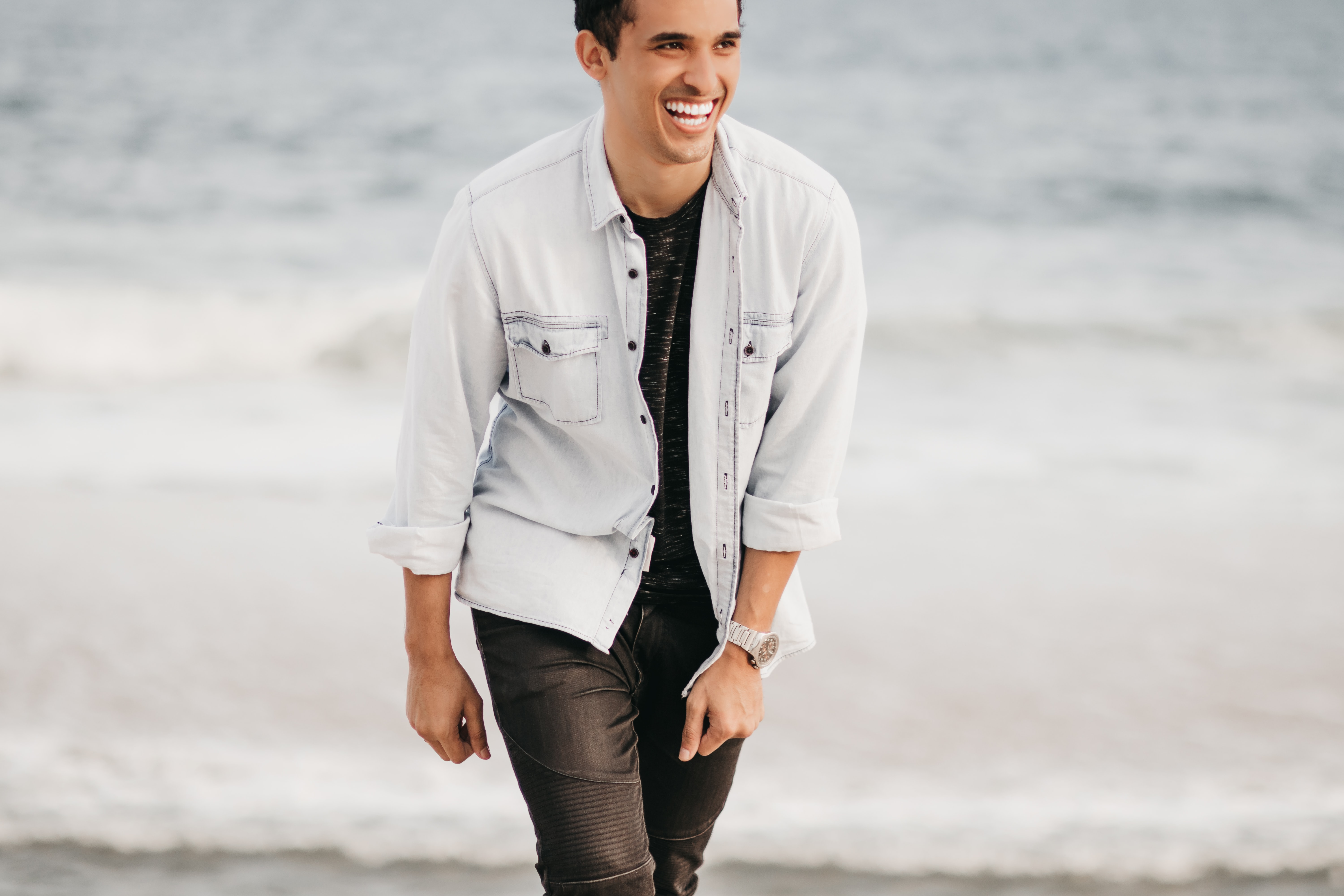 man standing on shore smiling