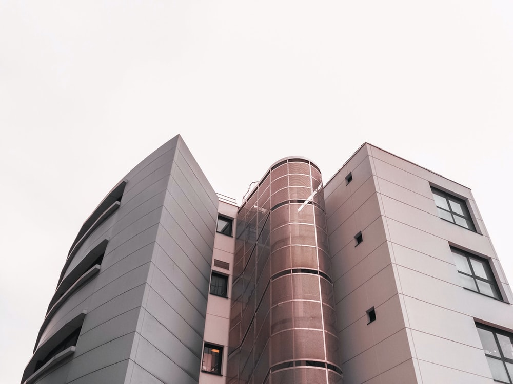 low angle photography of brown and white concrete building