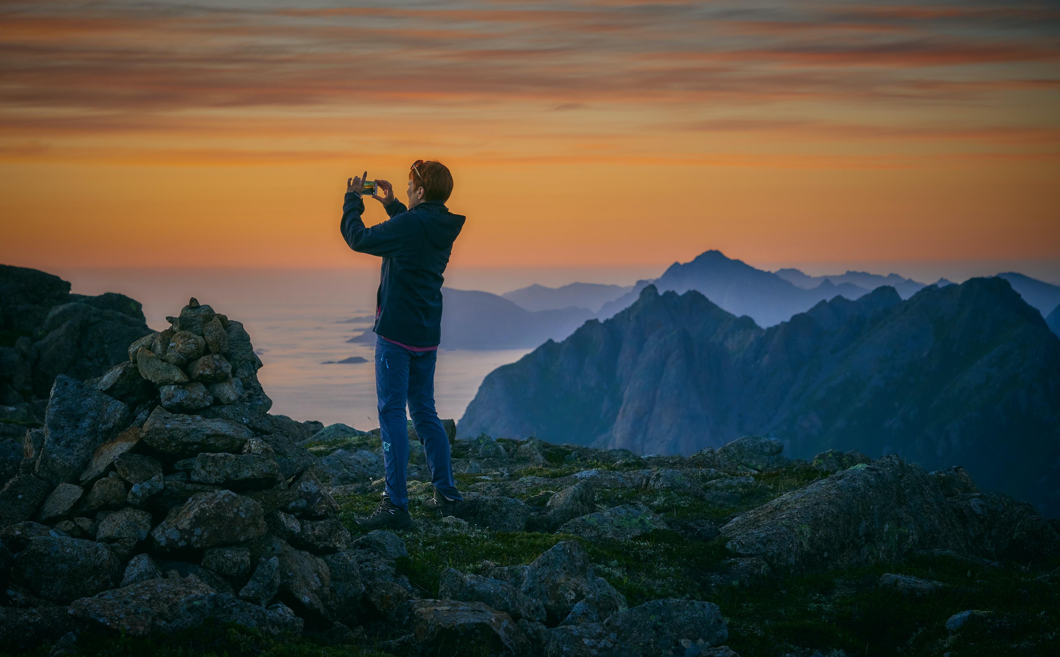 man standing on stones during daytime