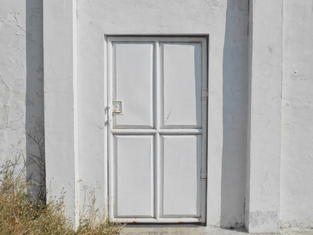 closed white door during daytime