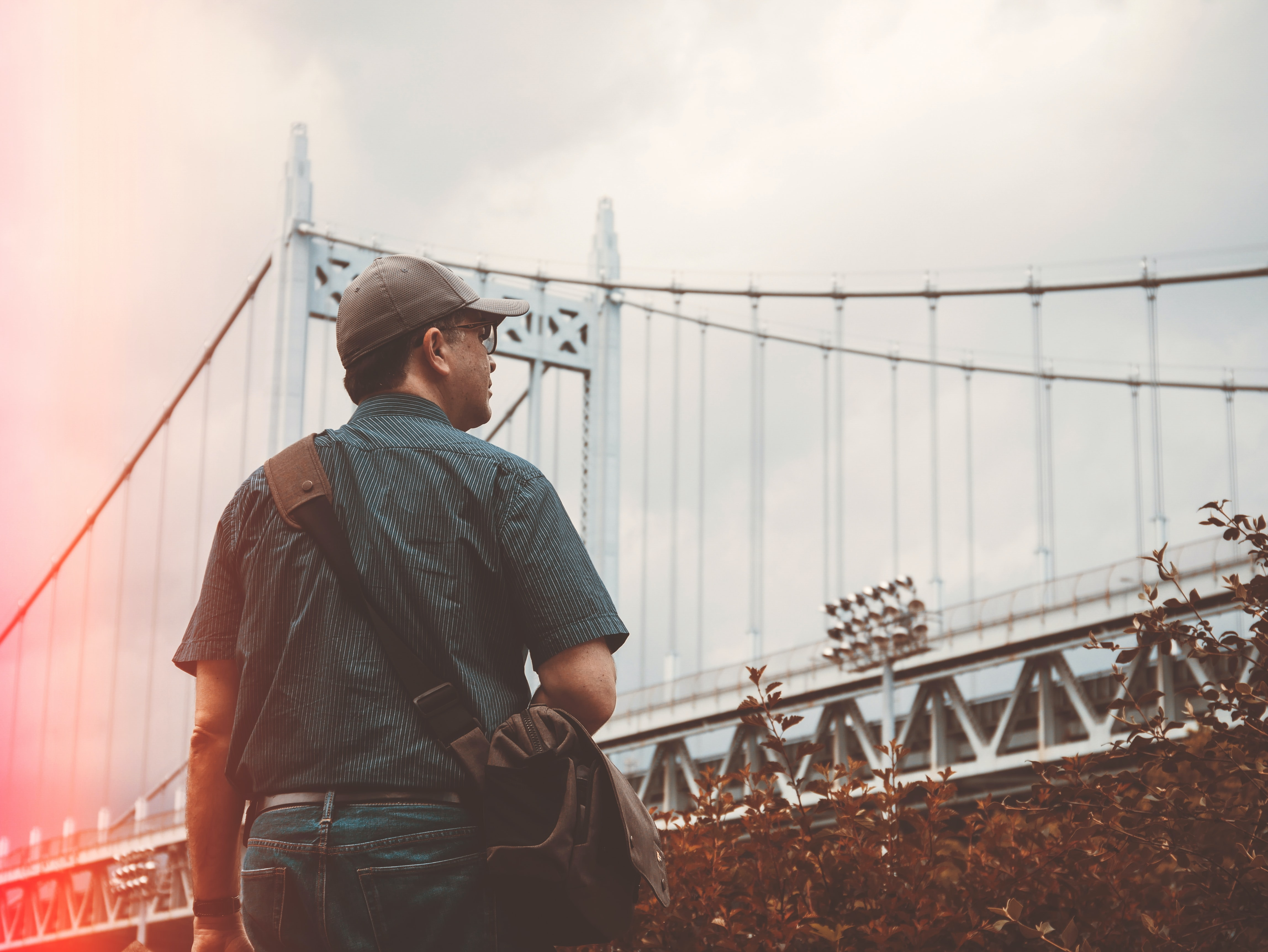 man standing near bridge