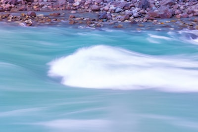 sea waves on rocky shore at daytime bahrain zoom background