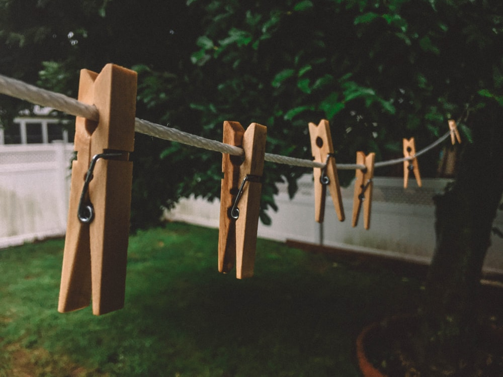 brown clothespin in white rope