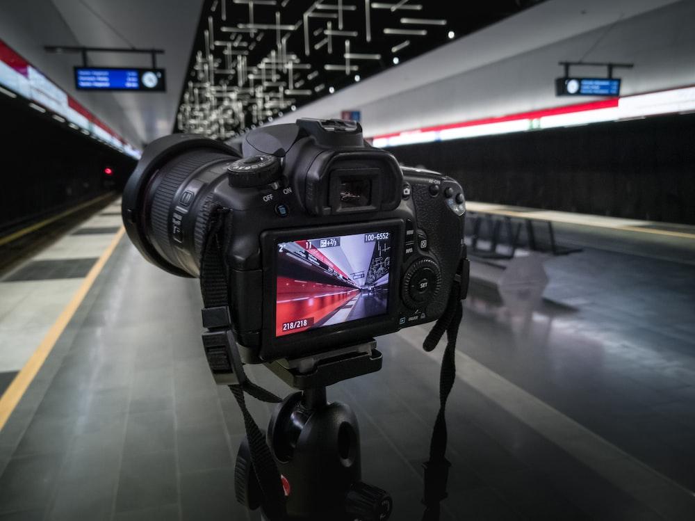black canon dslr camera on black tripod