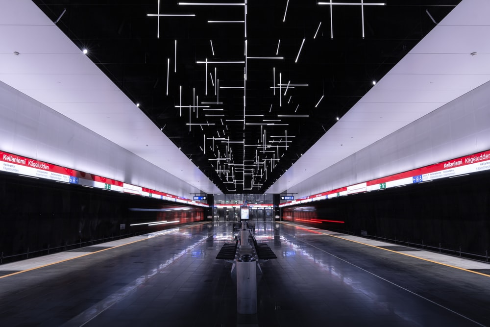 train subway station with switched-on lights