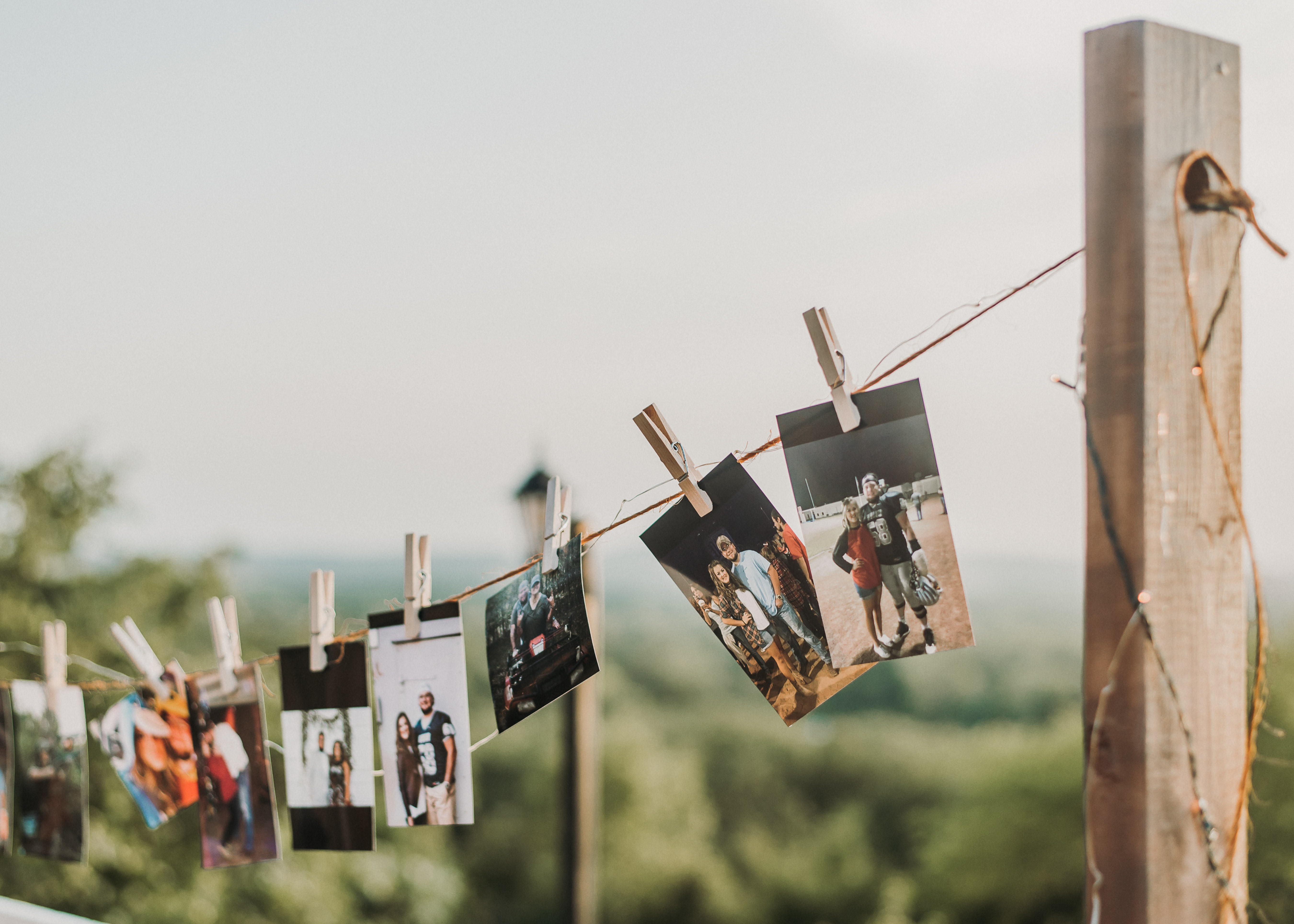 photos clipped on clothesline
