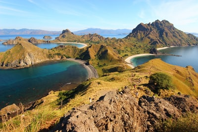 birds eye view of body of water and island indonesia zoom background