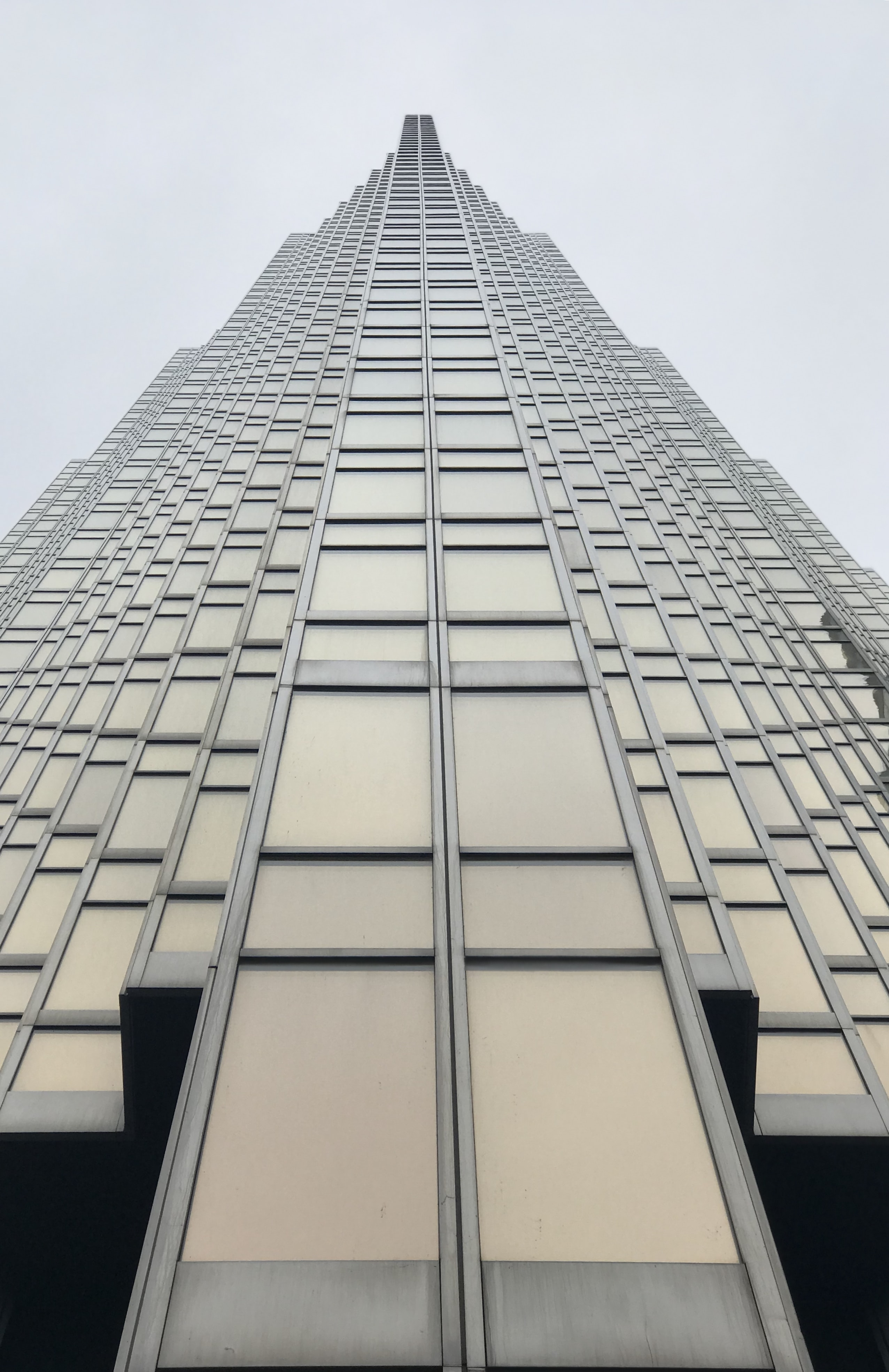 low angle photography of grey glass building