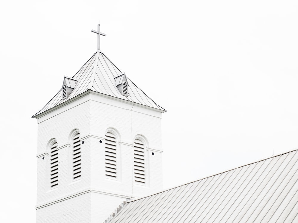 low angle photo of white church