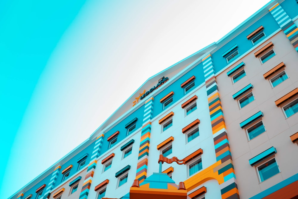 low angle photo of highrise multicolored building