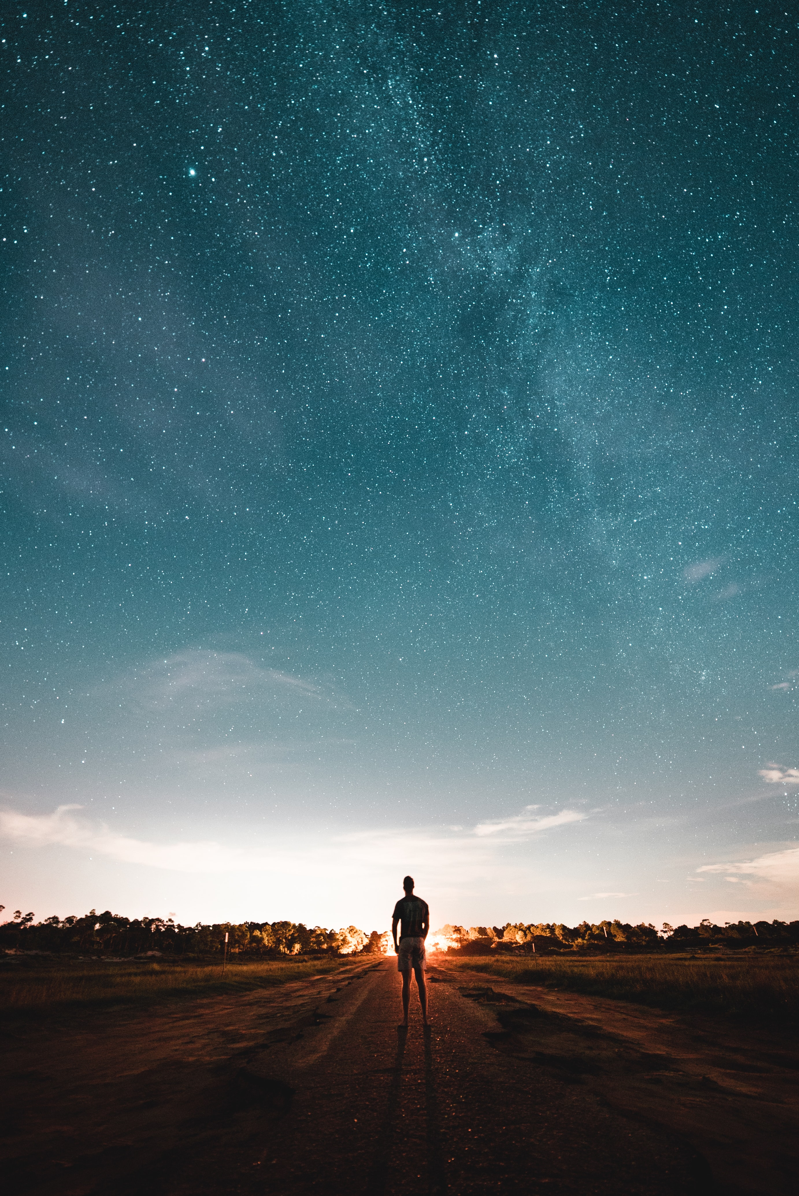 silhouette photo of man under star full sky