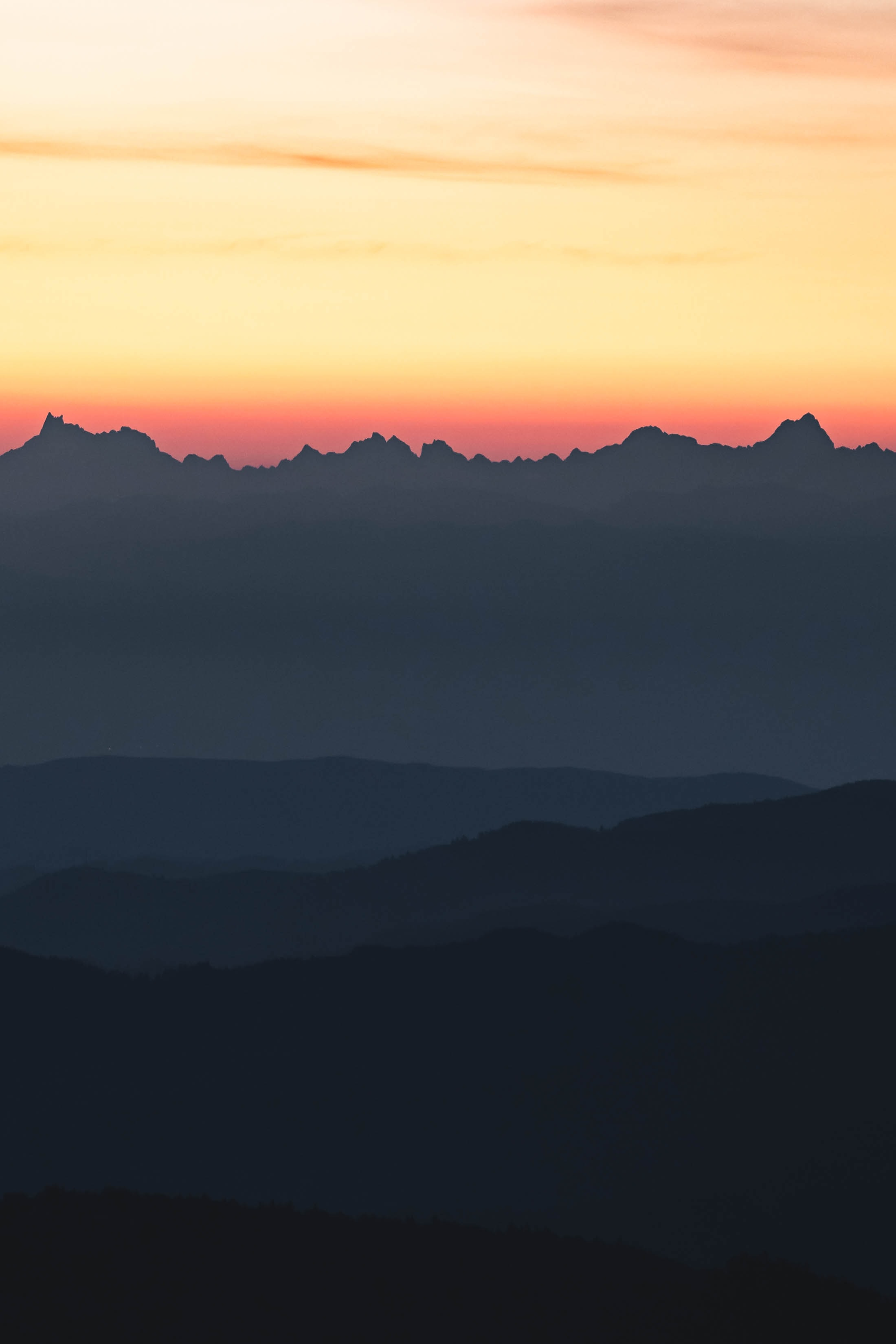 silhouette of mountain during sunse