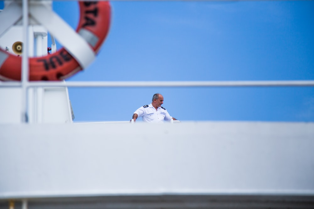 ship captain standing on top