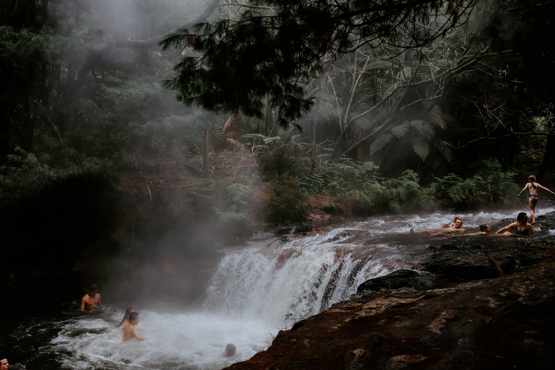 group of people on waterfalls